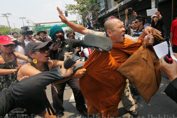 "Pro-Thaksin ""red shirts"" assault a monk who allegedly condemned their mob in passing.Violence against those who merely speak up against the means, methods, and mission of the red shirts is one of their infamous trademarks."