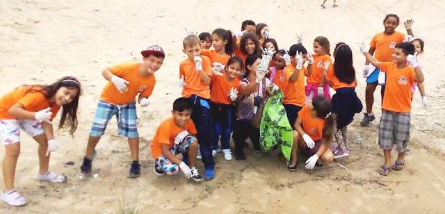 Mutirão ecológico nas dunas de Juruvaúva uniu crianças e idosos e recolheu 1.200 quilos de detritos