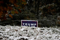 Snow falls on a campaign sign for U.S. Republican presidential nominee Donald Trump in the village of Kingston, New York, U.S., as the first winter weather of the season moved into parts of the northeast U.S., October 27, 2016. (Credit: Reuters/Mike Segar) Click to Enlarge.