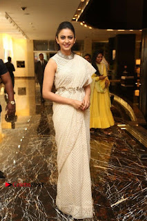 Actress Rakul Preet Singh Stills in White Dress at Winner Pre Release Function  0052.jpg