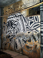 Street art of a Black and white creature