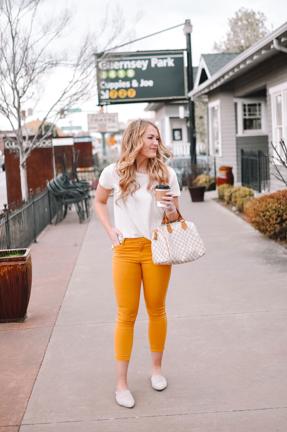 Blogger Amanda Martin wears yellow pants and a spotted tee for a coffee date in the Uptown 23rd District of OKC