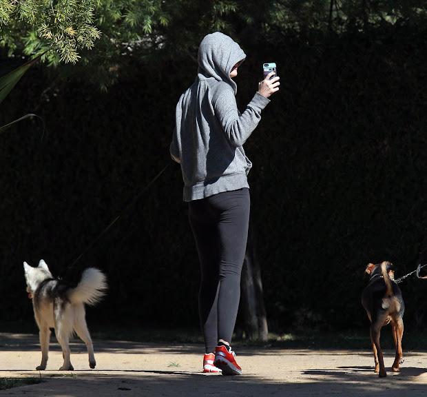 Miley Cyrus Walking Dog