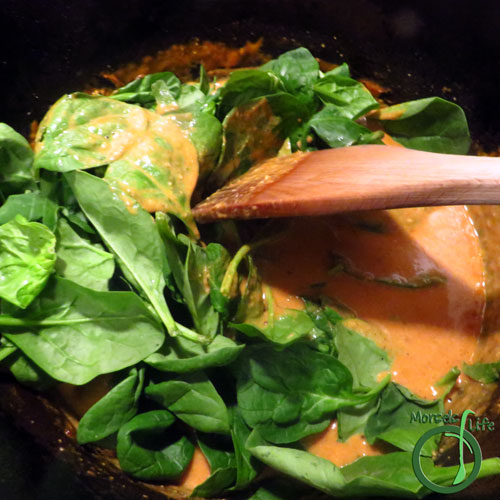 Morsels of Life - Curry Chicken Step 6 - Once chicken is cooked, remove from heat and toss in spinach, wilting it. Serve over rice.