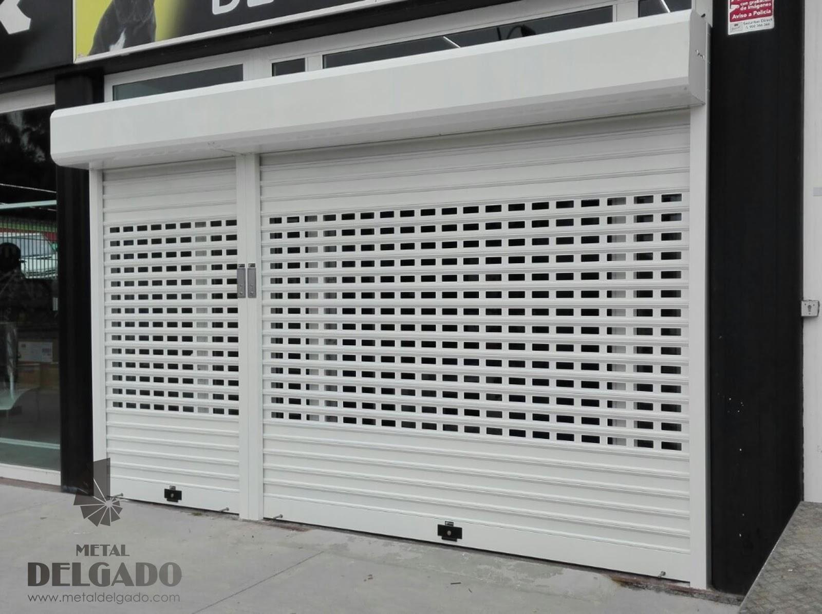 Puertas garaje tenerife puertas enrollables locales for Puertas automaticas garaje