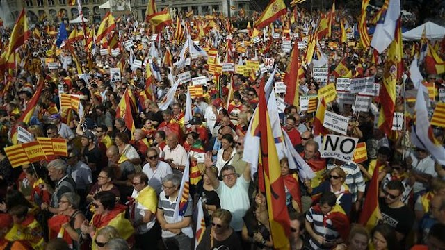 Spaniards rally in Madrid and Barcelona to show unity after banned referendum of Catalonia