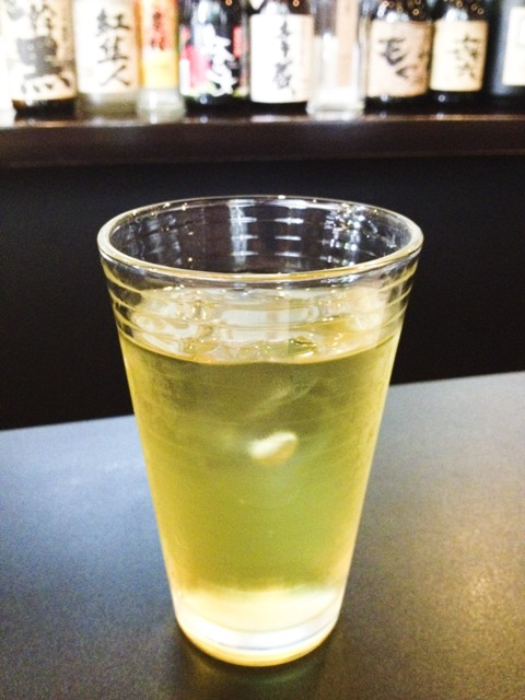 A glass of cold green tea