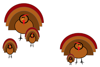 5 turkeys of different sizes and looking in different directions