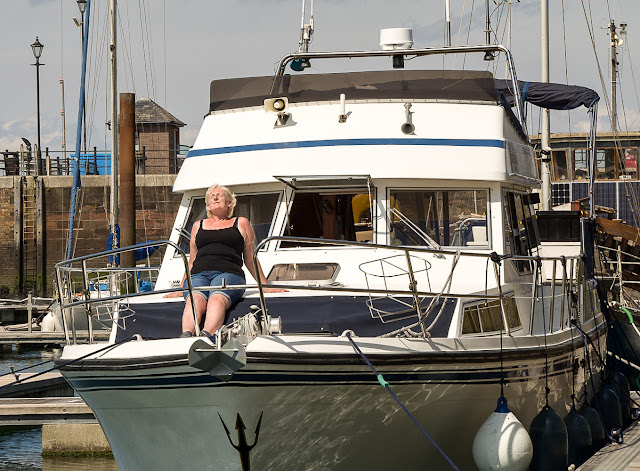 Photo of chilling out and enjoying the sunshine on Ravensdale's fore deck