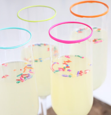 http://kailochic.blogspot.com/2015/08/craft-it-neon-rimmed-champagne-glasses.html