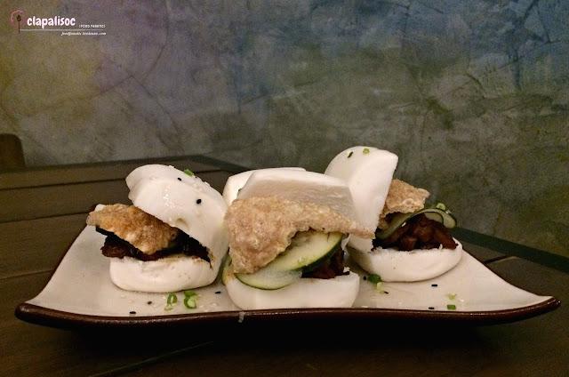 Braised Pork Belly Bao with Crispy Pork Skin from Nomads Makati