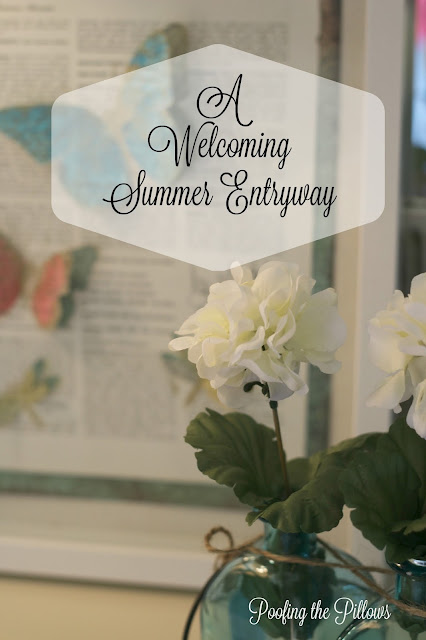 summer entryway, foyer, butterfly art, mercury glass, geraniums