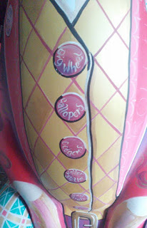 Painted buttons on the front of a large plastic hare.