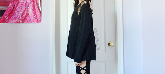 All-black long sleeve distressed ripped heart cutout grunge oversized sweater from SheIn.