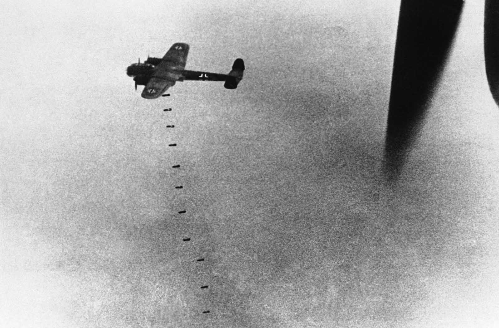 A German aircraft drops its load of bombs above England, during an attack on September 20, 1940.