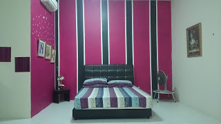 Bilik tidur Utama di Raisya Homestay Putrajaya