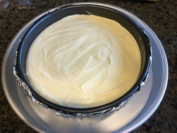 New York Style Cheesecake filling in a springform pan