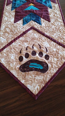 http://www.craftsy.com/pattern/quilting/home-decor/bear-claw-applique-template/175018