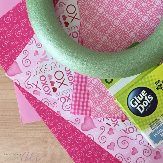 scrapbook paper wreath form and glue dots to make wreath