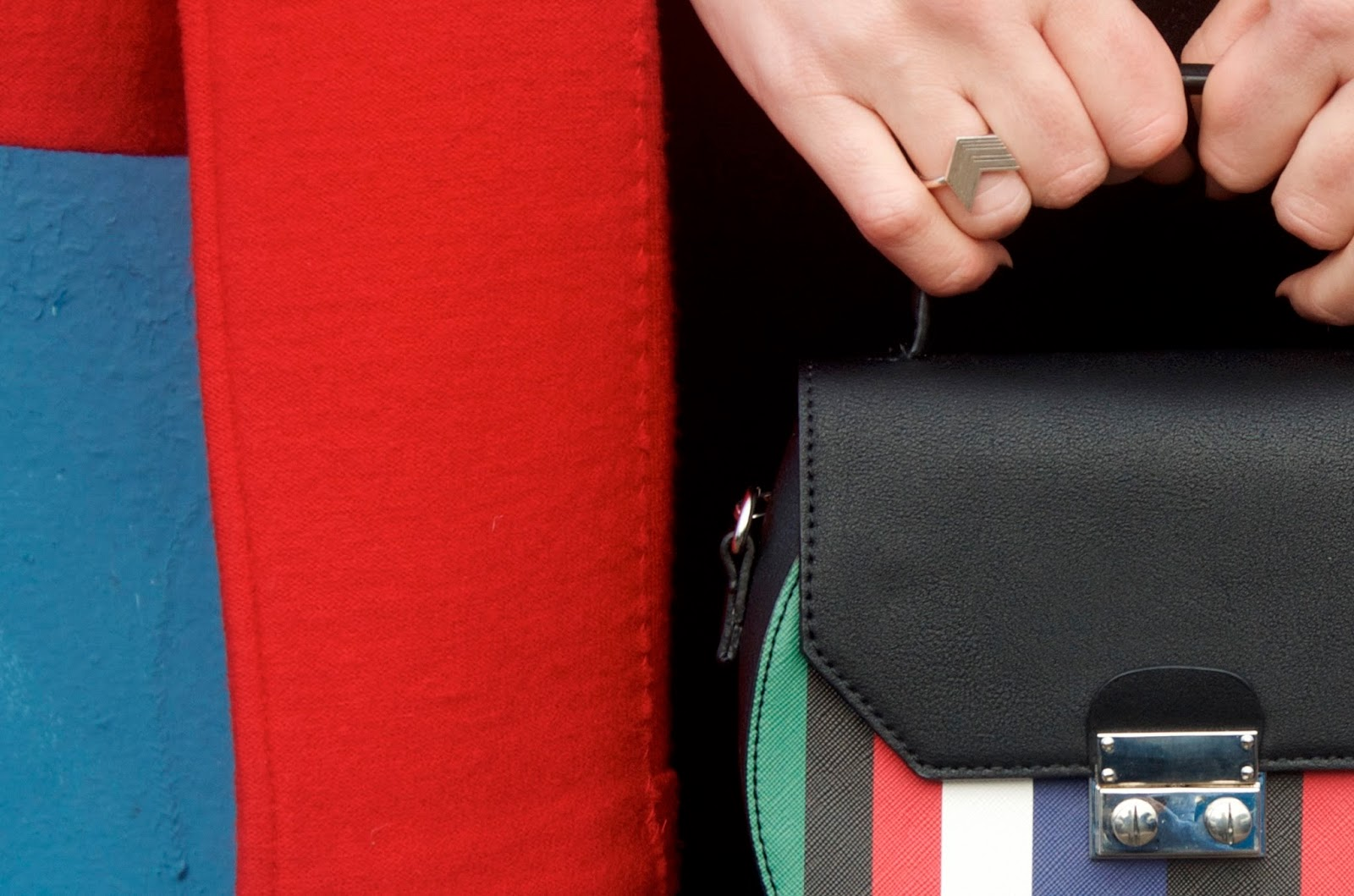 stripe bag, silver arrow ring and red coat