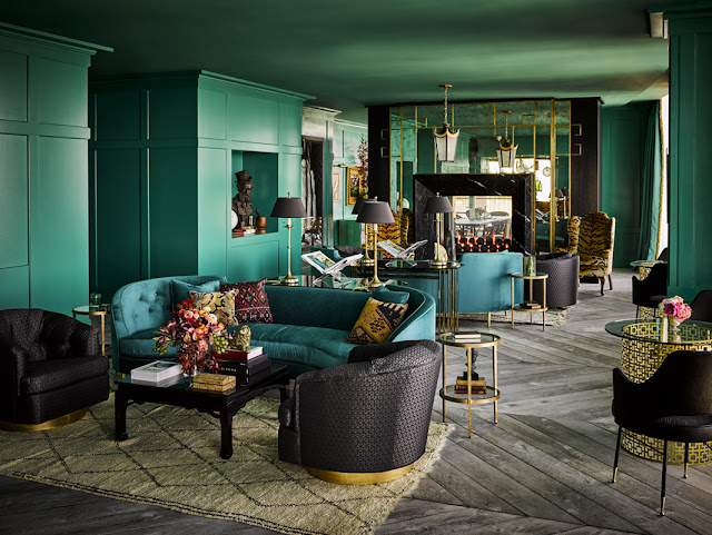 Teal green lacquer painted walls in dramatic lounge by Ken Fulk