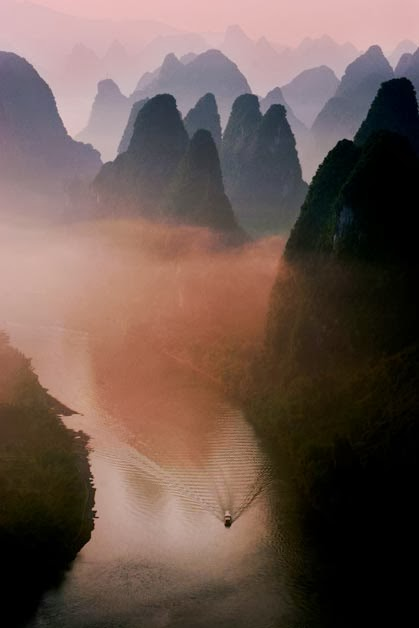 A boat passing through the mountains by Ted Lee