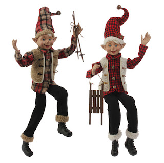 Christmas elf in flannel, sheep skin, sled and ski poles