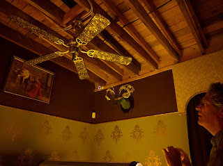 ceiling fan and wall decorations at joystick