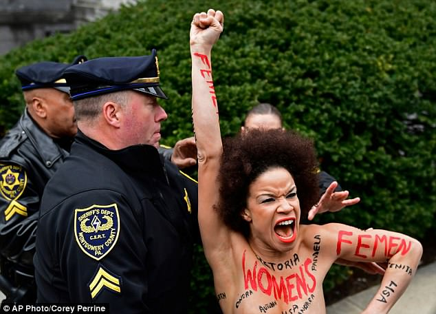 Actress-Nicolle-Rochelle-stages-Topless-Protest-at-Bill-Cosbys-Trial
