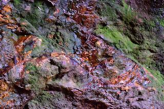 Colorful rock walls at Rio Viejo, Puriscal