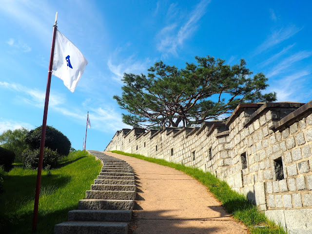 White flags up the steps of Hwaseong fortress walls, around Suwon, Gyeonggi-do, South Korea