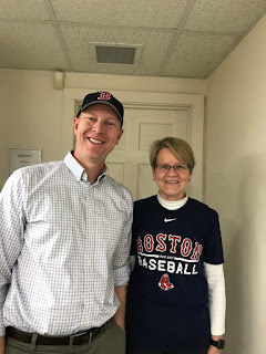 Mr. Runyan and Dr. Houle modeling our Red Sox gear! He's much taller than me - I stood on a step to make it work!