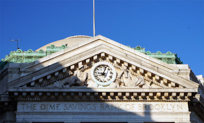 Closeup of pediment over entrance of Dime Savings Bank in Downtown Brooklyn