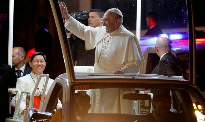 Pope Francis waves to crowd