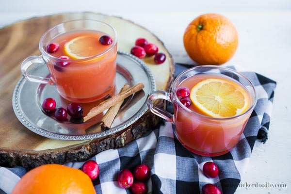 This Holiday Wassail recipe is cooked in the slow cooker and simply amazing!  A perfect holiday drink for everyone to enjoy!  |  mynameissnickerdoodle.com