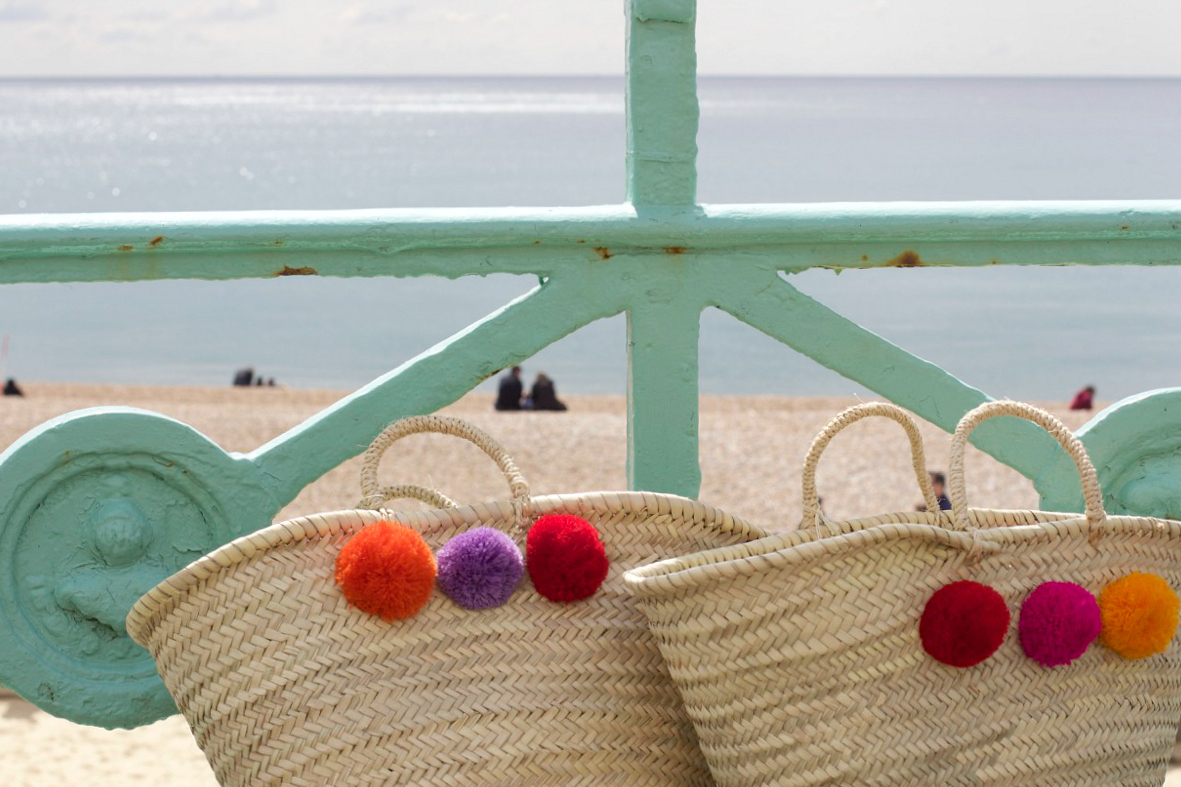 moroccan pom pom woven basket bag in brighton
