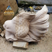 Patung air mancur ikan hias / ikan mas koki dari batu alam paras jogja atau batu alam paras putih