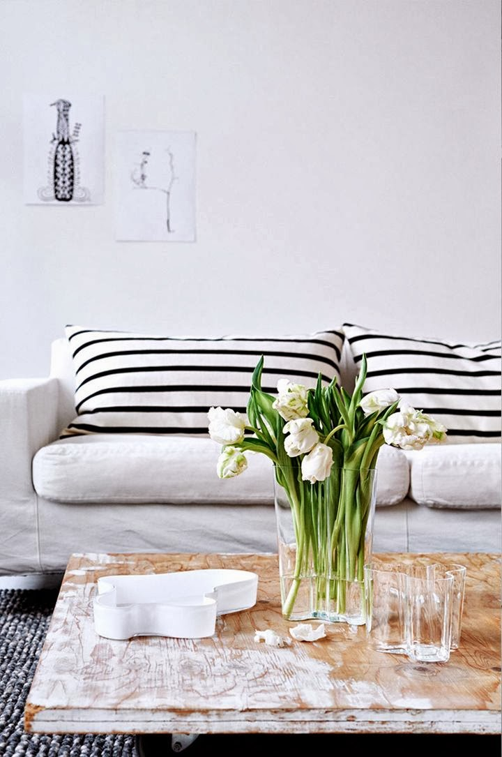 Black and white striped cushions and neutral interior design
