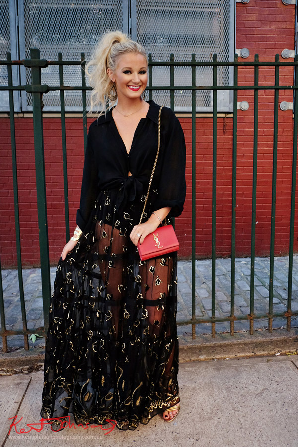 A sheer black maxi skirt with gold embroider details with black blouse and red YSL clutch with gold chain strap. Street Fashion Sydney - New York Edition photographed by Kent Johnson