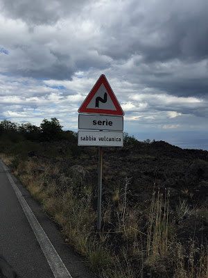 Signs on the roads around Mount Etna warning of volcanic sand and ash.