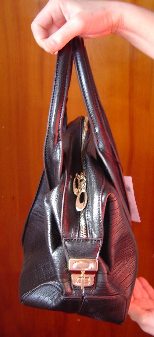 side view of Twisted Orchid Black Doc Supreme Handbag
