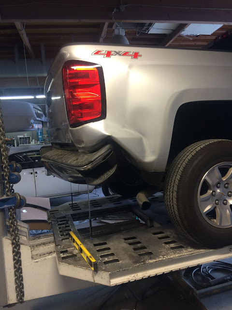 Chevy Silverado on frame rack during collision repairs at Almost Everything Auto Body