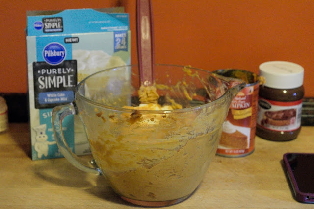 The cake mix, pumpkin puree, pumpkin pie spice, all combined in the mixing bowl