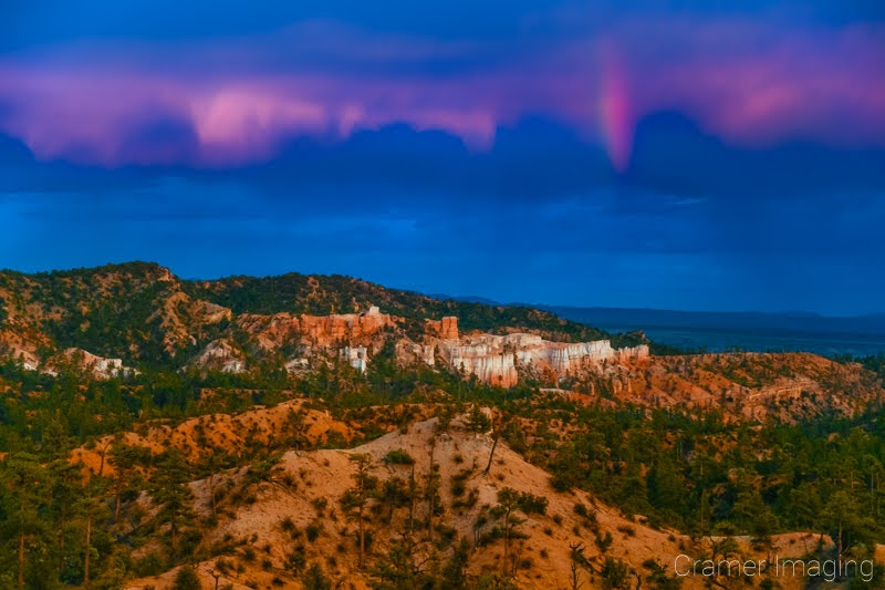 Cramer Imaging's fine art landscape photograph of cotton candy pink clouds over the lookout point at Bryce Canyon National Park Utah