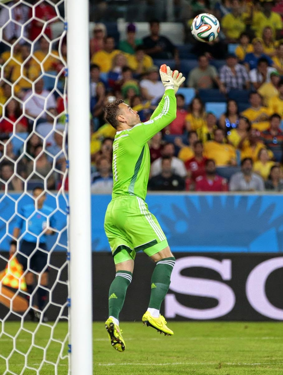 Russia's goalkeeper Igor Akinfeev catches the ball in front of the goal mouth during the group H World Cup soccer match between Russia and South Korea at the Arena Pantanal in Cuiaba, Brazil, Tuesday, June 17, 2014.