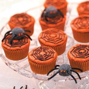 orange spider web halloween cupcakes