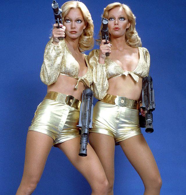 girls posing with guns
