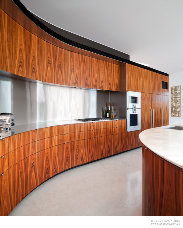 Curved wooden furniture in the kitchen