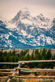 Fine art landscape photograph of a rustic wooden fence against the Grand Teton of Grand Teton National Park Wyoming by Cramer Imaging