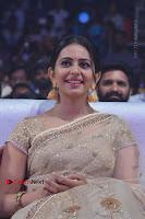 Actress Rakul Preet Singh Stills in Golden Embroidery saree at Rarandoi Veduka Chuddam Audio Launch .COM 0015.jpg